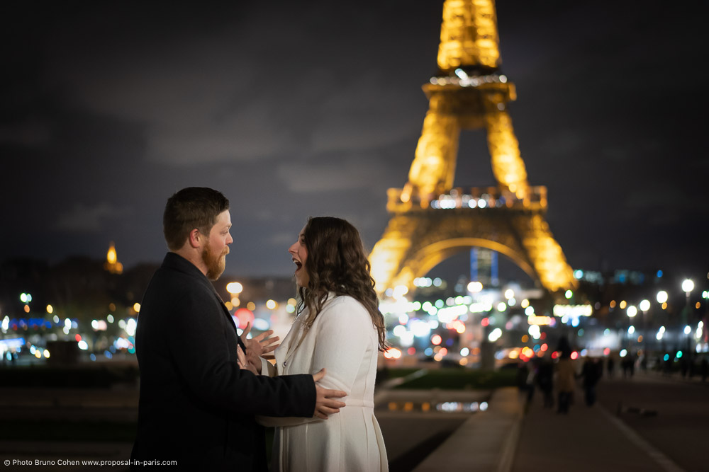 proposal emotions front of Eiffel Tower at night