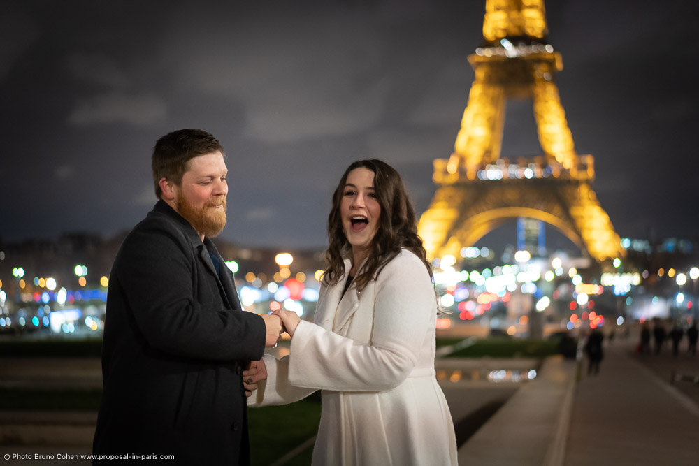 surprise lady after proposal in front Eiffel Tower at night