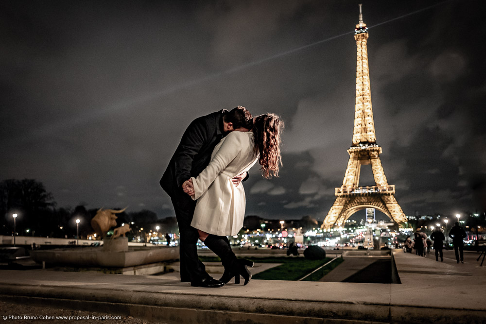 couple in love dancing from the Trocadero front of Eiffel Tower at night