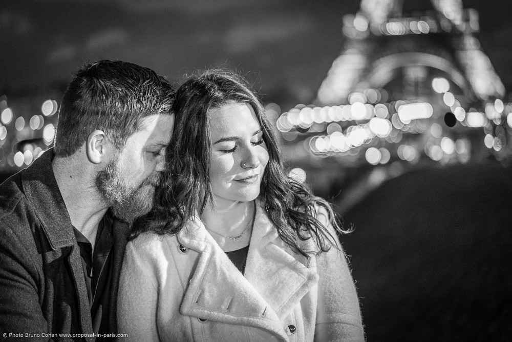 couple in love front of Eiffel Tower in black and white