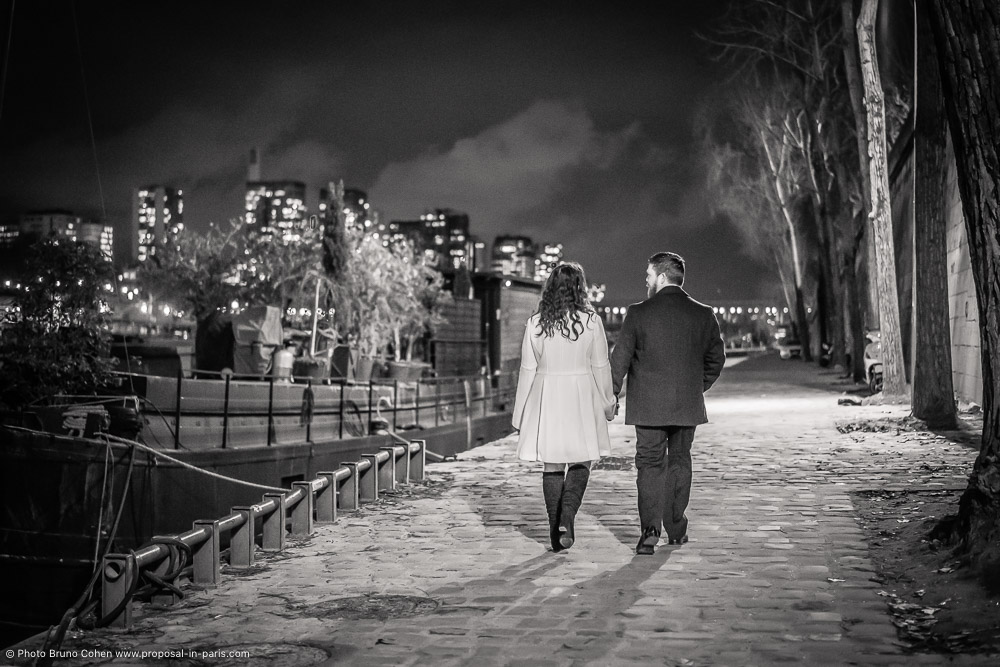 couple walking at night in paris black and white