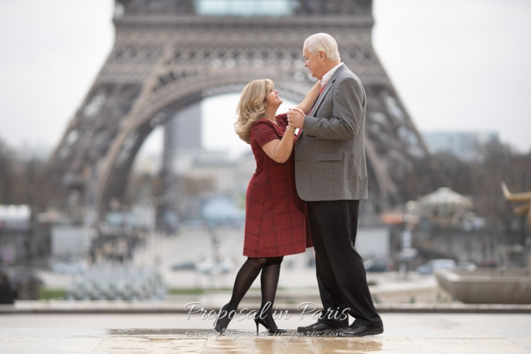 dancing couple in front of the Eiffel tower Paris
