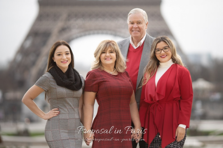 classic family portrait group shot in front of the Eiffel tower Paris
