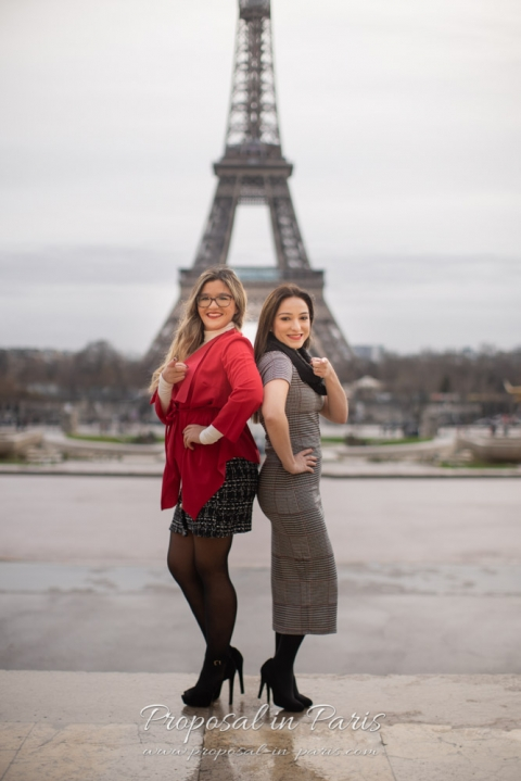 sisters in front of the Eiffel Tower Paris