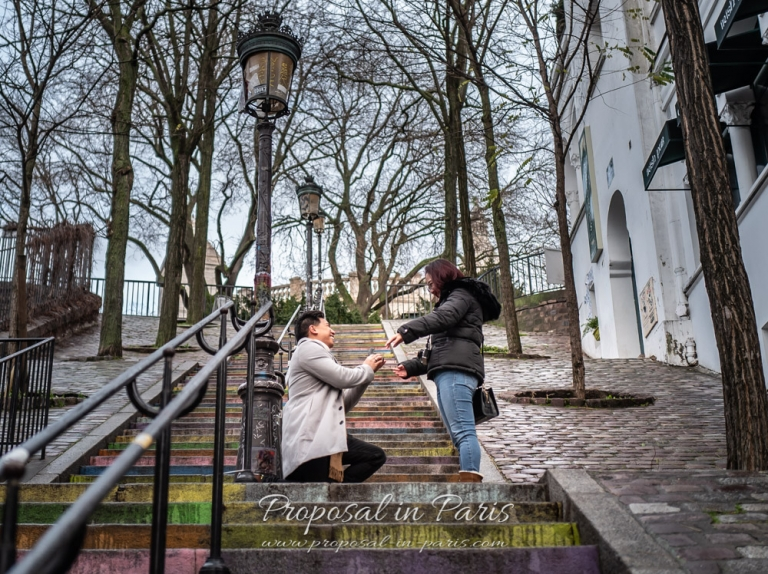 Marriage proposal on stairs near Sacre Coeur