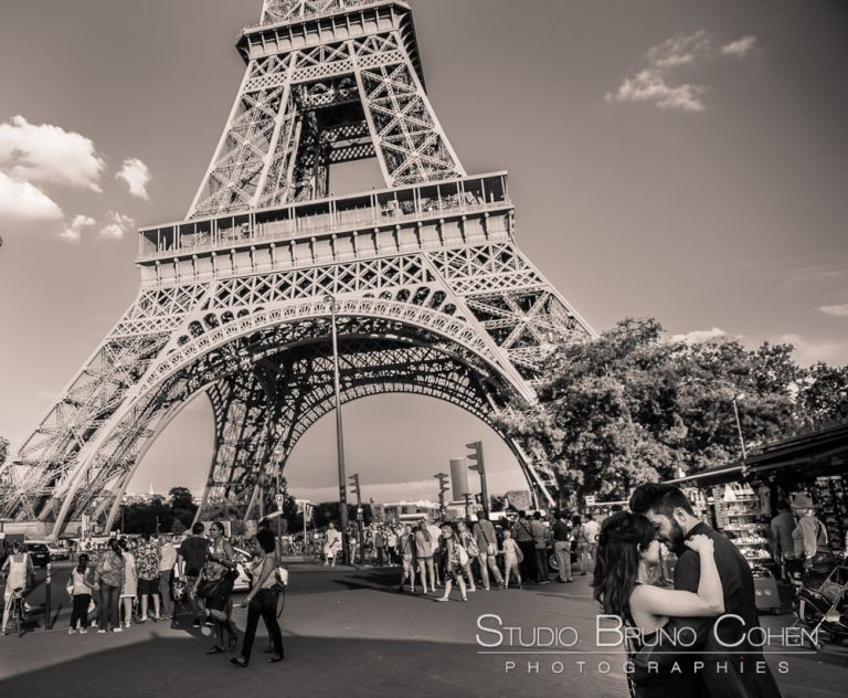 proposal in paris couple in love forehead against forehead front of eiffel tower black in white summer