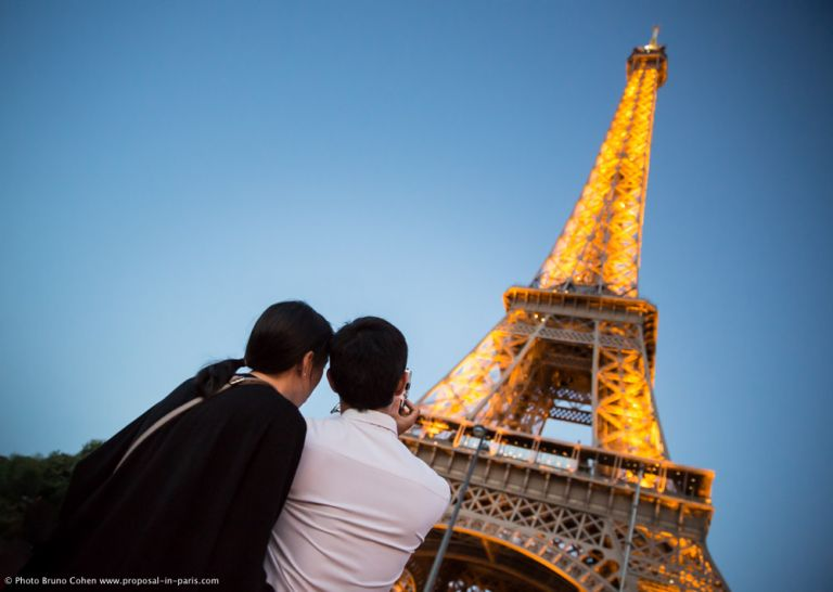 proposal in Paris front of Eiffel Tower sparkles couple in love